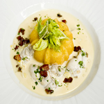 Oyster Stew with Cornbread topped with Celery leaf salad